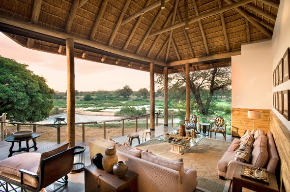 Relax on the patio of Dulini River Lodge.